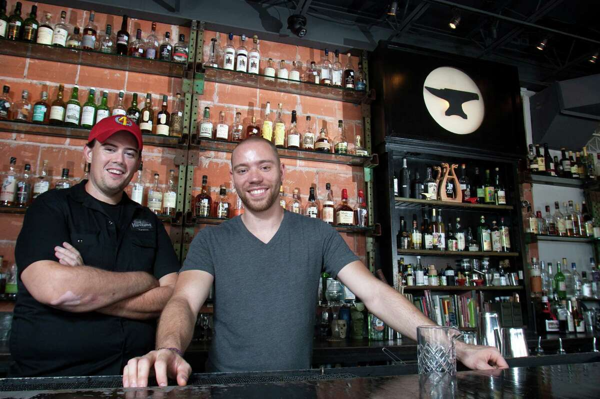 Bar owners Kevin Floyd (left) and his partner Bobby Heugel pose for a portrait in the Anvil Bar and Refuge on Wednesday, Aug. 29, 2012, in Houston. ( J. Patric Schneider / for the Chronicle )