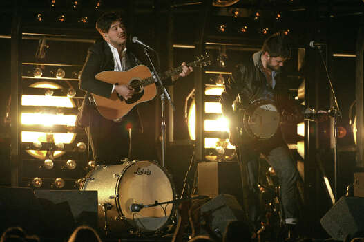 Marcus Mumford, left, and Winston Marshall, of musical group Mumford & Sonsa, perform at the 55th annual Grammy Awards on Sunday, Feb. 10, 2013, in Los Angeles. Photo: John Shearer, Associated Press / Invision