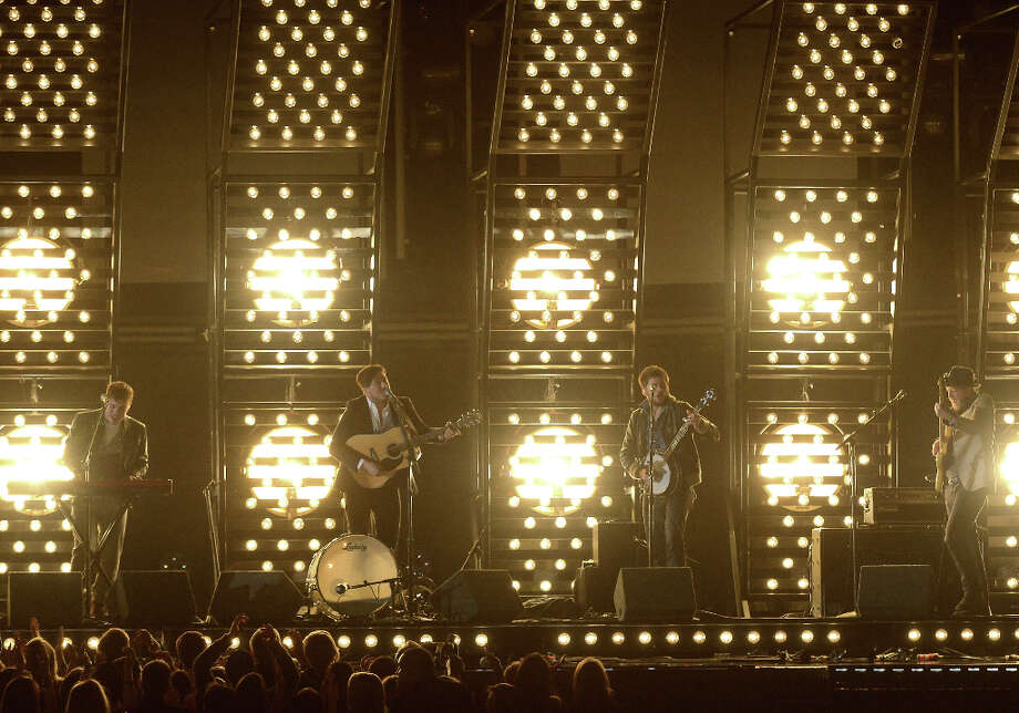 Musicians Ben Lovett (L-R), Marcus Mumford, Winston Marshall and Ted Dwane of Mumford & Sons perform onstage at the 55th Annual GRAMMY Awards at Staples Center on February 10, 2013 in Los Angeles, California. Photo: Kevork Djansezian, Getty Images / 2013 Getty Images