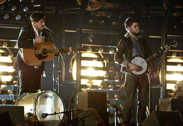 Marcus Mumford, left, and Winston Marshall, of musical group Mumford & Sons, perform at the 55th annual Grammy Awards on Sunday, Feb. 10, 2013, in Los Angeles. Photo: John Shearer, Associated Press / Invision