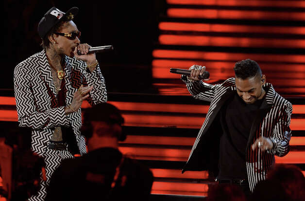 Rapper Wiz Khalifa and singer Miguel perform onstage at the 55th Annual GRAMMY Awards at Staples Center on February 10, 2013 in Los Angeles, California. Photo: Kevork Djansezian, Getty Images / 2013 Getty Images