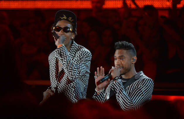 Miguel and Wiz Khalifa perform at the Staples Center during the 55th Grammy Awards in Los Angeles, California, February 10, 2013. Photo: JOE KLAMAR, AFP/Getty Images / AFP