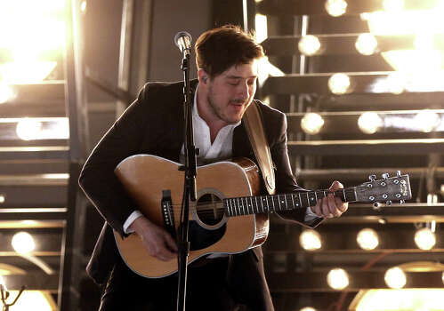 Singer Marcus Mumford of Mumford & Sons performs onstage during the 55th Annual GRAMMY Awards at STAPLES Center on February 10, 2013 in Los Angeles, California. Photo: Christopher Polk, Getty Images For NARAS / 2013 Getty Images