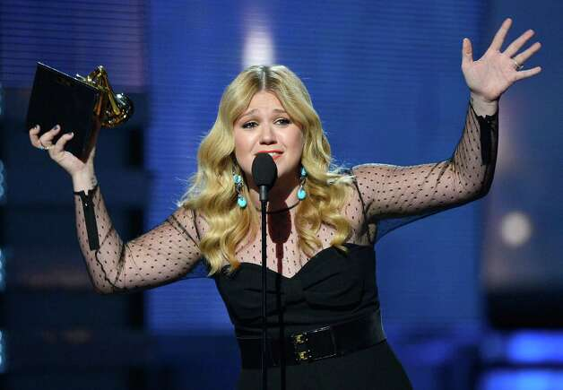 "LOS ANGELES, CA - FEBRUARY 10:  Singer Kelly Clarkson accepts Best Pop Vocal Album award for ""Stronger"" onstage at the 55th Annual GRAMMY Awards at Staples Center on February 10, 2013 in Los Angeles, California. Photo: Kevork Djansezian, Getty Images / 2013 Getty Images"