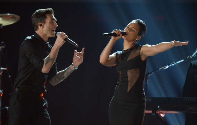 Alicia Keys and Adam Levine from Maroon 5 perform on stage at Staples Center during the 55th Grammy Awards in Los Angeles, California, February 10, 2013. Photo: JOE KLAMAR, AFP/Getty Images / AFP