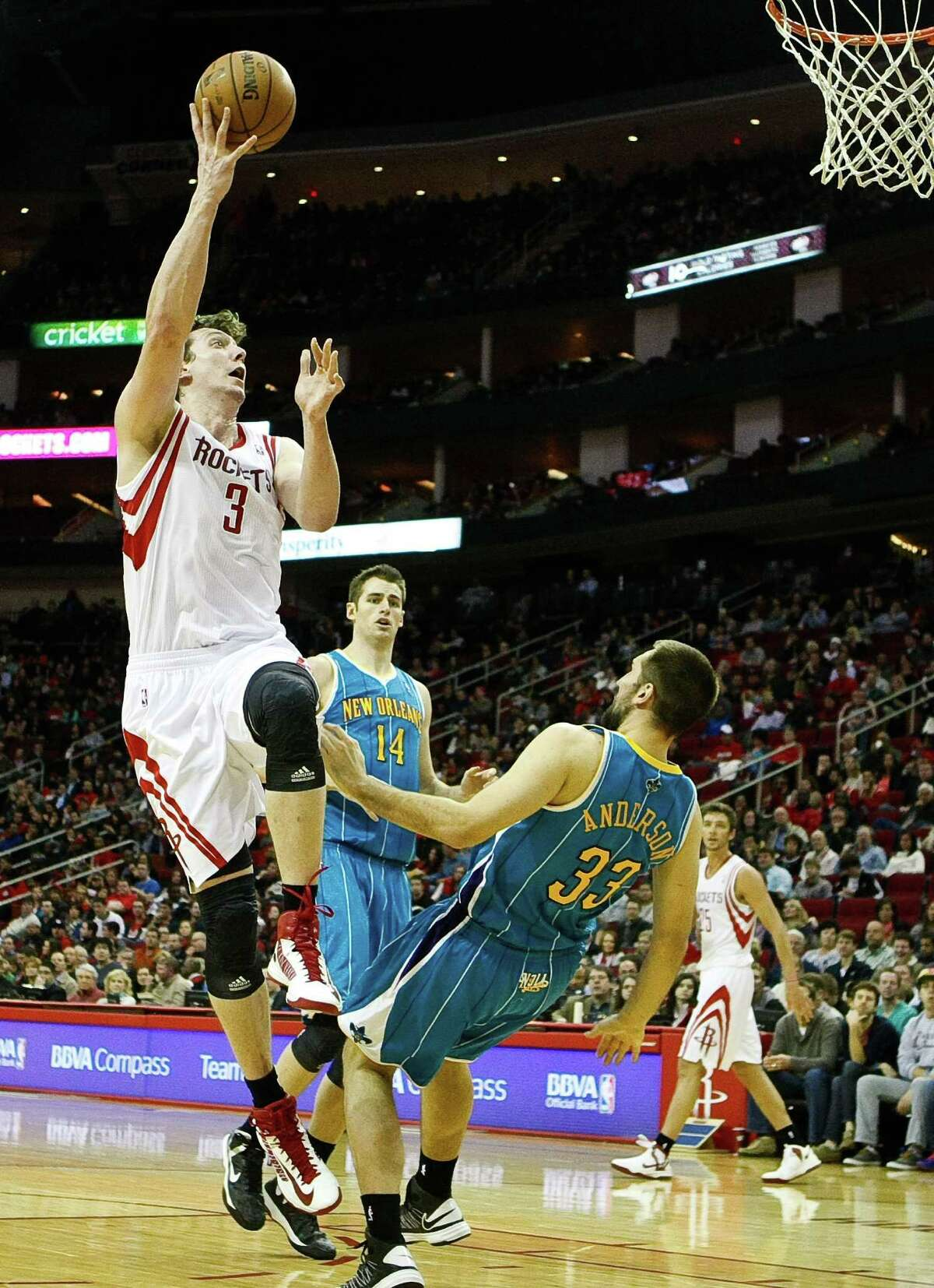 A move by Omer Asik (3) brings a fall from the Hornets' Ryan Anderson that could be interpreted as the type of flopping maneuver the NBA is trying to curb.