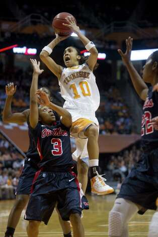 Tennessee's Meighan Simmons attempts to score over Mississippi's Valencia McFarland during Sunday's victory. Simmons, a former Steele standout, scored a game-high 24 points as one of five Lady Vols in double figures and led them to their 24th straight win over the Rebels. Photo: Saul Young / Knoxville News Sentinel