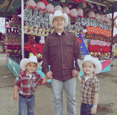 Rodeo goers enjoy the sights, sounds and tastes at the San Antonio Stock Show & Rodeo Sunday night, Feb. 10, 2013. Photo: Xelina Flores-Chasnoff, MySA.com