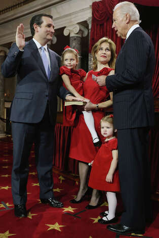 U.S. Sen. Ted Cruz (R-TX) (L) participates in a reenacted swearing-in with his wife  Heidi Nelson Cruz, daughters Caroline and Catherine, and U.S. Vice President Joe Biden (R) in the Old Senate Chamber at the U.S. Capitol  January 3, 2013 in Washington, DC. Biden swore in the newly-elected and re-elected senators earlier in the day on the floor of the current Senate chamber. Photo: Chip Somodevilla, Getty Images / 2013 Getty Images