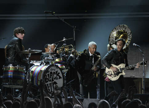 Patrick Carney, left, and Dan Auerbach, second from right, of musical group The Black Keys, perform on stage at the 55th annual Grammy Awards on Sunday, Feb. 10, 2013, in Los Angeles. Photo: John Shearer, Associated Press / Invision