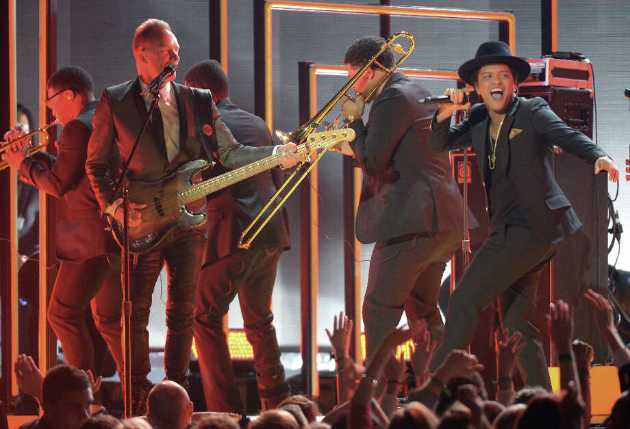 Sting and Bruno Mars perform on stage at the Staples Center during the 55th Grammy Awards in Los Angeles, California, February 10, 2013. Photo: JOE KLAMAR, AFP/Getty Images / AFP