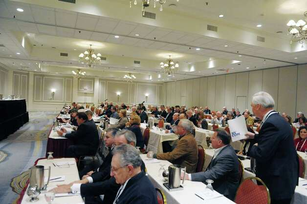 Attendees at the New York Conference of Mayors and Municipal Officials take part in an opening session on the State budget and legislation at the Hotel Albany on Sunday evening, Feb. 10, 2013 in Albany, NY.  (Paul Buckowski / Times Union) Photo: Paul Buckowski
