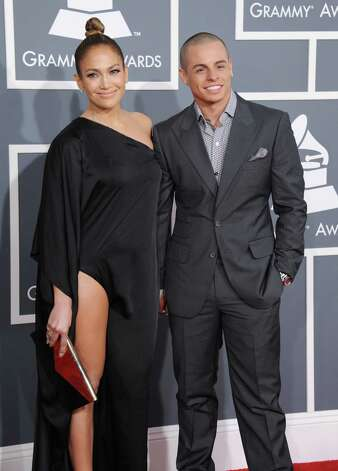 Jennifer Lopez, left, and Casper Smart arrive at the 55th annual Grammy Awards on Sunday, Feb. 10, 2013, in Los Angeles.  (Photo by Jordan Strauss/Invision/AP) Photo: Jordan Strauss