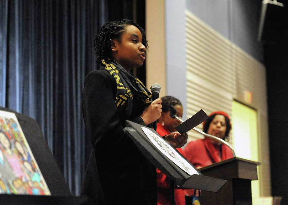 Delenn Lloyd-Latif, a senior at Bethlehem Central High School, talks about her winning  artwork during the 17th Annual Black History Month Creative Expression Contest Awards Ceremony at Stephen & Harriet Myers Middle School on Sunday, Feb. 10, 2013 in Albany, NY.  The contest and awards are sponsored by the Albany, New York Alumnae Chapter of Delta Sigma Theta Sorority.  Over 130 students in grades 3 through 12 from public, private and parochial schools in the Capital Region competed this year.  (Paul Buckowski / Times Union) Photo: Paul Buckowski