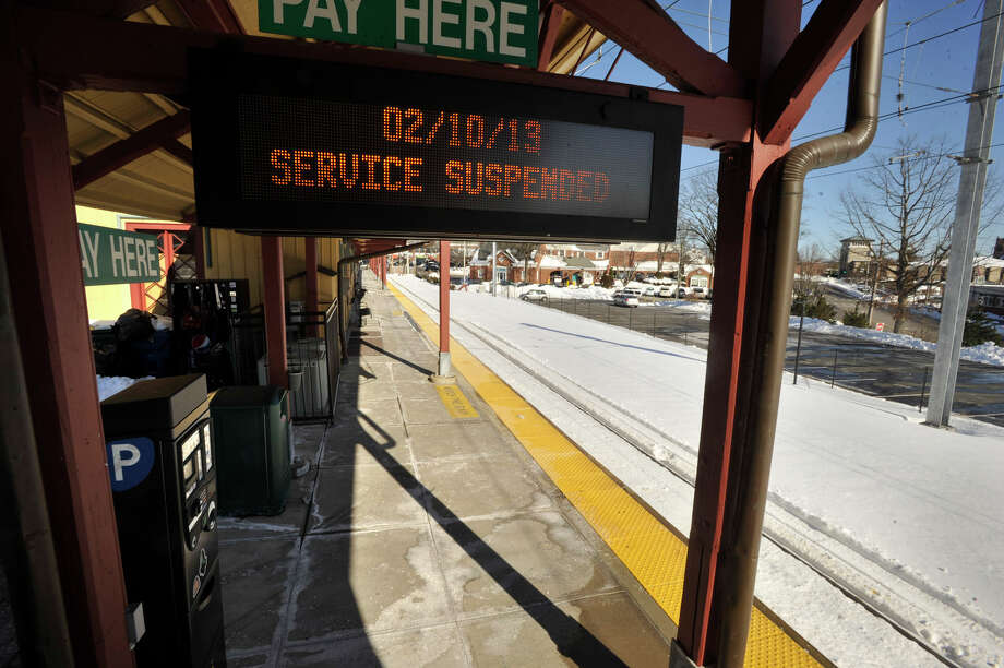 A notice to Metro-North commuters that the New Canaan line has been suspended is displayed at the New Canaan train station on Sunday, Feb. 10, 2013. Photo: Jason Rearick / The News-Times