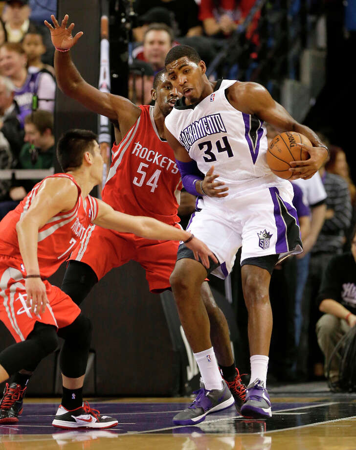 Kings forward Jason Thompson tries to work out of the double team of Jeremy Lin and Patrick Patterson. Photo: Rich Pedroncelli, Associated Press / AP