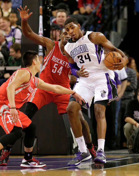Kings forward Jason Thompson tries to work out of the double team of Jeremy Lin and Patrick Patterso