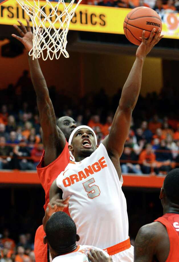 Syracuse's C.J. Fair (5) shoots against St. John's during the second half of an NCAA college basketball game in Syracuse, N.Y., Sunday, Feb. 10, 2013. Syracuse won 77-58. (AP Photo/Kevin Rivoli) Photo: KEVIN RIVOLI