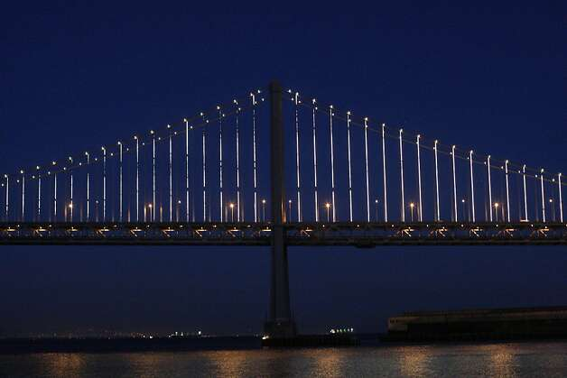 Leo Villareal's light show on the Bay Bridge can be seen from Pier 14 on Sunday, Feb. 10. Villareal used 25,000 LED lights to illuminate the Bay Bridge for the Grand Lighting on March 5. Photo: James Tensuan, The Chronicle