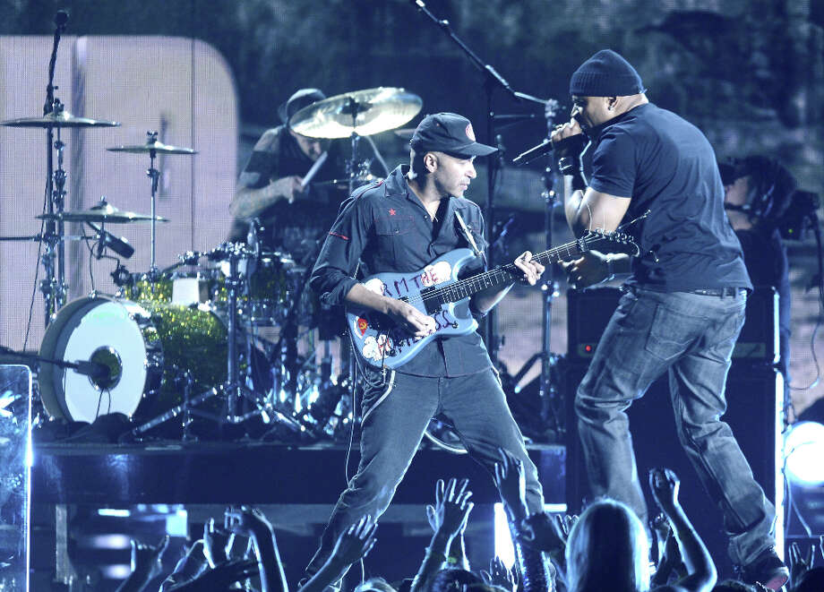 Musician Tom Morello (L) and rapper LL Cool J perform onstage at the 55th Annual GRAMMY Awards at Staples Center on February 10, 2013 in Los Angeles, California. Photo: Kevork Djansezian, Getty Images / 2013 Getty Images