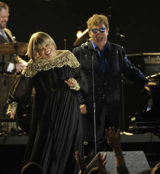 Mavis Staples, left, and Elton John perform a tribute to Levon Helm at the 55th annual Grammy Awards on Sunday, Feb. 10, 2013, in Los Angeles. Photo: John Shearer, Associated Press / Invision