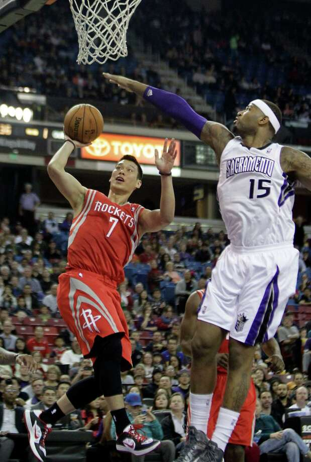 Rockets guard Jeremy Lin, right, drives against the defense of Kings center DeMarcus Cousins during the first quarter Sunday night. Lin had 12 points on 5-for-8 shooting before fouling out. Photo: Rich Pedroncelli, STF / AP