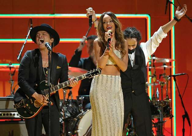 Recording artists Bruno Mars, left, and Rihanna perform a tribute to Bob Marley at the 55th annual Grammy Awards on Sunday, Feb. 10, 2013, in Los Angeles. Photo: John Shearer, Associated Press