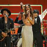 Recording artists Bruno Mars, left, and Rihanna perform a tribute to Bob Marley at the 55th annual Grammy Awards on Sunday, Feb. 10, 2013, in Los Angeles.