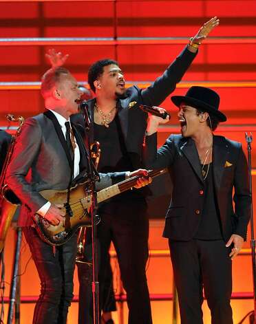 Musicians Sting, left, and Bruno Mars perform a tribute to Bob Marley at the 55th annual Grammy Awards on Sunday, Feb. 10, 2013, in Los Angeles. Photo: John Shearer, Associated Press