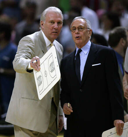 Spurs Head coach Gregg Popovich, left and Pistons head coach Larry Brown talk before game one of the NBA Finals at the SBC Center in San Antonio on June 9, 2005. (WILLIAM LUTHER/STAFF) Photo: WILLIAM LUTHER, Express-News / SAN ANTONIO EXPRESS-NEWS