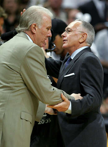 Spurs Gregg Popovich, left and Pistons Larry Brown greet on another before the start of	game 7 of the NBA Finals at the SBC Center in San Antonio June 23, 2005. (Kin Man Hui/staff) Photo: KIN MAN HUI, Express-News / SAN ANTONIO EXPRESS-NEWS