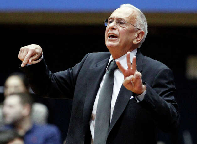 FILE - In this Nov. 28, 2012, file photo, SMU head coach Larry Brown instructs his team during an NCAA college basketball game against Utah in Dallas.  Brown hopes the Big East can stay intact for at least another basketball season or two. Three things drew the veteran coach to the SMU job: the school, city and conference. The last of those is uncertain even before the Mustangs play a game in their new league. (AP Photo/Tony Gutierrez, File) Photo: Tony Gutierrez, Associated Press / AP