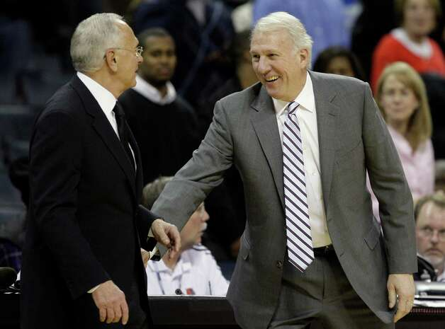 Charlotte Bobcats coach Larry Brown, left, and San Antonio Spurs coach Gregg Popovich, right, talk after the Bobcats' 92-76 win in an NBA basketball game in Charlotte, N.C., Friday, Jan. 15, 2010. (AP Photo/Chuck Burton) Photo: Chuck Burton, Associated Press / AP