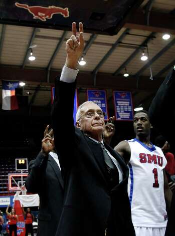 SMU head coach Larry Brown, and Ryan Manuel (1) celebrate their 62-55 win against Utah as the school song is played following an NCAA college basketball game Wednesday, Nov. 28, 2012, in Dallas. (AP Photo/Tony Gutierrez) Photo: Tony Gutierrez, Associated Press / AP