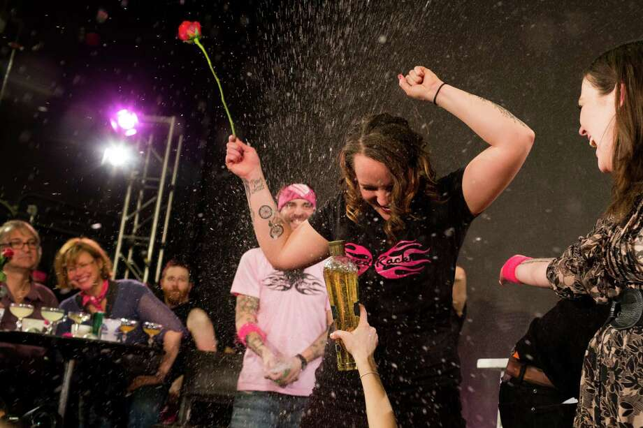 Portland resident and bartender Lacy Hawkins, center right, is showered with alcohol after winning the final cocktail creation round during the Seattle leg of Speed Rack on Sunday, Feb. 10, 2013, at Century Ballroom in Seattle. Hawkins was crowned Miss Speed Rack Seattle. It was her first time winning the competition. Speed Rack is a national cocktail competition that pits the top female bartenders in key cocktail markets against each other in timed and judged challenges. One hundred percent of the proceeds from the tour's ten stops will be donated to breast cancer education, prevention and research. Photo: JORDAN STEAD / THE EMERALD COLLECTIVE, FOR SEATTLEPI.COM / FOR SEATTLEPI.COM