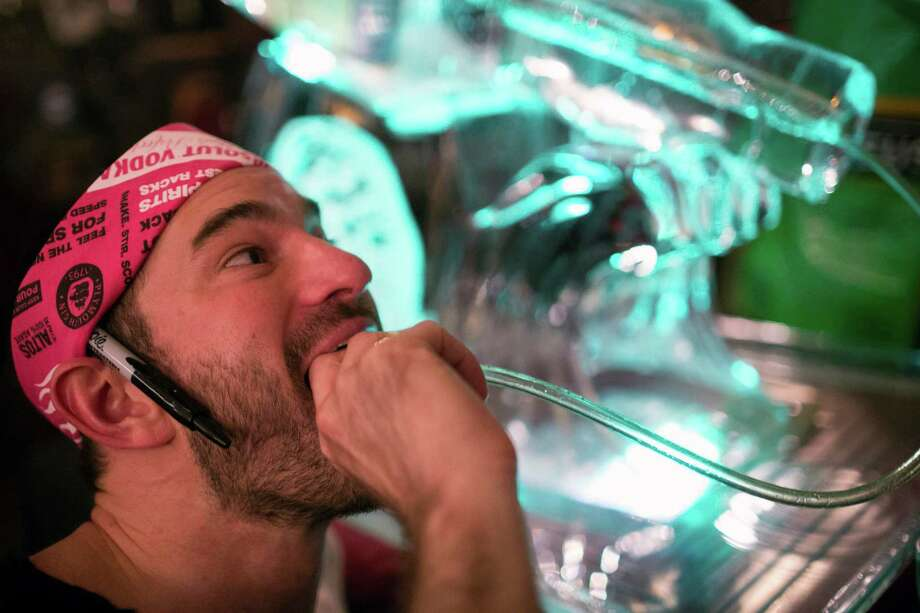Attendee Philip Thompson takes a turn at an alcohol ice luge. Photo: JORDAN STEAD / THE EMERALD COLLECTIVE, FOR SEATTLEPI.COM / FOR SEATTLEPI.COM