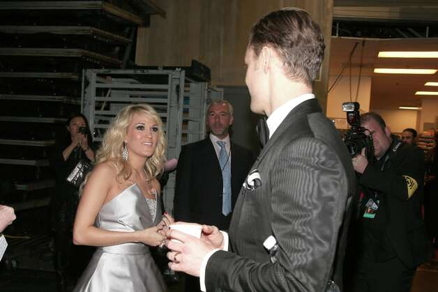 Singers Carrie Underwood and Justin Timberlake backstage during the 55th Annual GRAMMY Awards at STAPLES Center on February 10, 2013 in Los Angeles, California. Photo: Christopher Polk, Getty Images For NARAS / 2013 Getty Images
