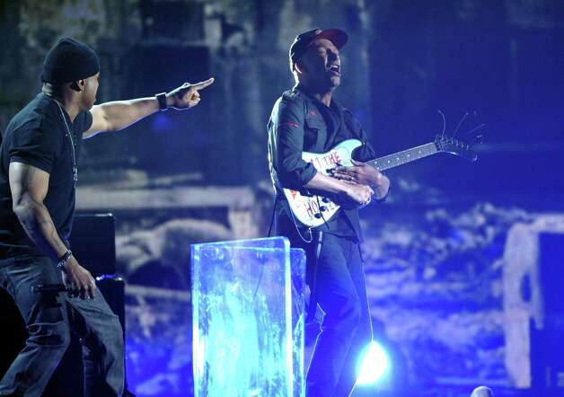 LL Cool J, left, and Tom Morello perform on stage at the 55th annual Grammy Awards on Sunday, Feb. 10, 2013, in Los Angeles. (Photo by John Shearer/Invision/AP) Photo: John Shearer, Associated Press / Invision