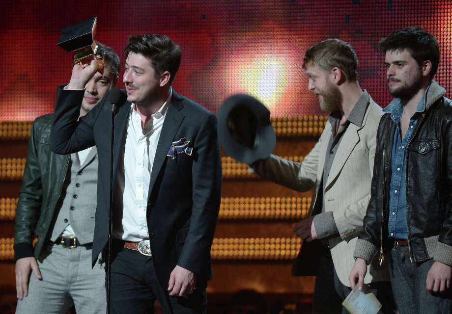 Winners for Best Album of the Year, the group Mumford & Sons, reacts on stage at the Staples Center during the 55th Grammy Awards in Los Angeles, California, February 10, 2013. AFP PHOTO Joe KLAMARJOE KLAMAR/AFP/Getty Images Photo: JOE KLAMAR, AFP/Getty Images / AFP