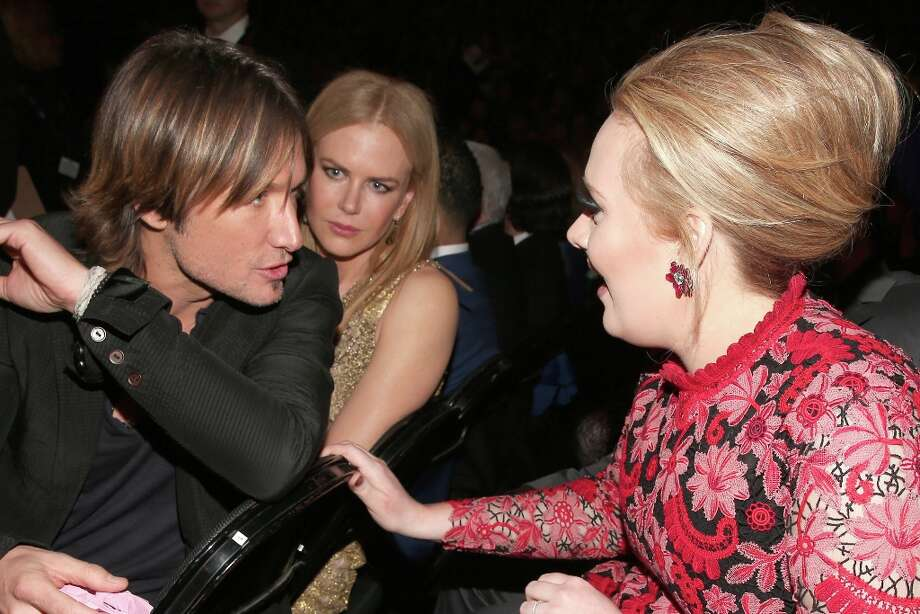 LOS ANGELES, CA - FEBRUARY 10:  (L-R) Singer Keith Urban, actress Nicole Kidman and singer Adele attend the 55th Annual GRAMMY Awards at STAPLES Center on February 10, 2013 in Los Angeles, California. Photo: Christopher Polk, Getty Images For NARAS / 2013 Getty Images
