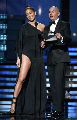 LOS ANGELES, CA - FEBRUARY 10:  Singers Jennifer Lopez and Pitbull speak onstage at the 55th Annual GRAMMY Awards at Staples Center on February 10, 2013 in Los Angeles, California. Photo: Kevork Djansezian, Getty Images / 2013 Getty Images