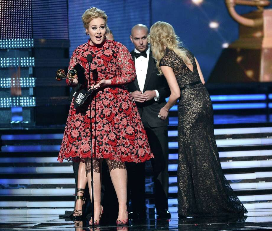 LOS ANGELES, CA - FEBRUARY 10:  Singer Adele accepts Best Pop Solo Performance for Set Fire to the Rain (Live) onstage at the 55th Annual GRAMMY Awards at Staples Center on February 10, 2013 in Los Angeles, California. Photo: Kevork Djansezian, Getty Images / 2013 Getty Images