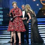 LOS ANGELES, CA - FEBRUARY 10:  Singer Adele accepts Best Pop Solo Performance for Set Fire to the Rain (Live) onstage at the 55th Annual GRAMMY Awards at Staples Center on February 10, 2013 in Los Angeles, California.