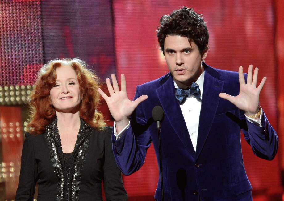 LOS ANGELES, CA - FEBRUARY 10:  Musicians Bonnie Raitt and John Mayer speak onstage at the 55th Annual GRAMMY Awards at Staples Center on February 10, 2013 in Los Angeles, California. Photo: Kevork Djansezian, Getty Images / 2013 Getty Images