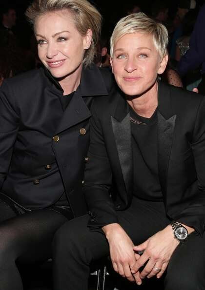 LOS ANGELES, CA - FEBRUARY 10:  Actress Portia de Rossi (L) and actress Ellen DeGeneres attend the 5