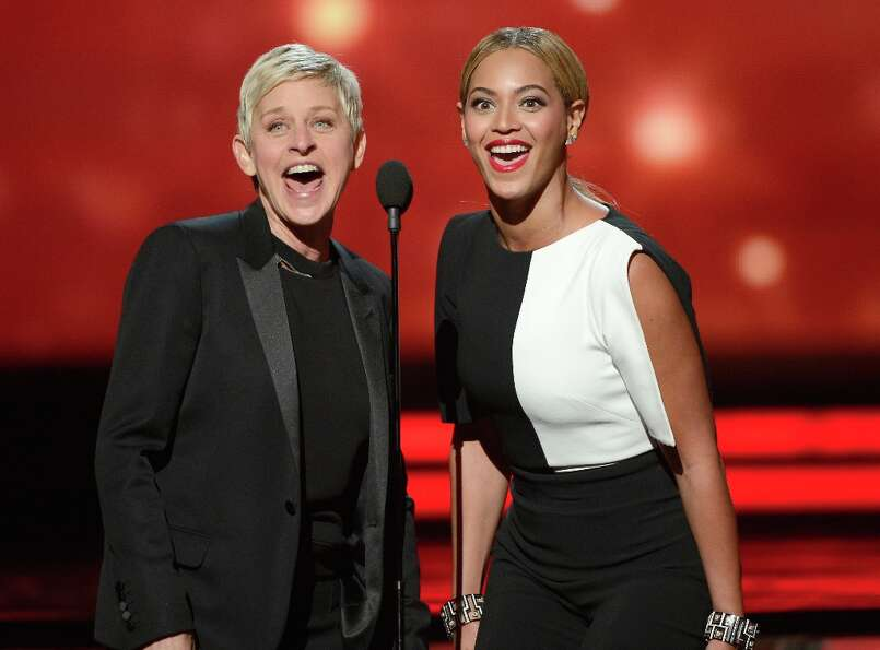 LOS ANGELES, CA - FEBRUARY 10:  TV personality Ellen DeGeneres (L) and singer Beyonce speak onstage