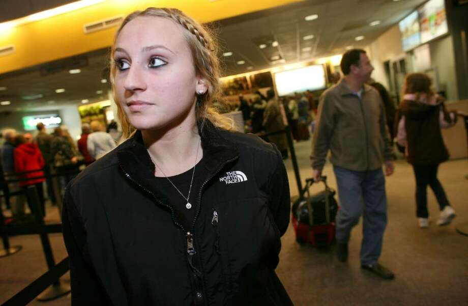 Despite some trepidation about flying after recent events involving airline terrorism Wolcott, Connecticut resident and Florida Atlantic student Sara Yashenko prepared to board her flight back to school at Westchester County Airport. Photo: David Ames, David Ames/For Greenwich Time / Greenwich Time