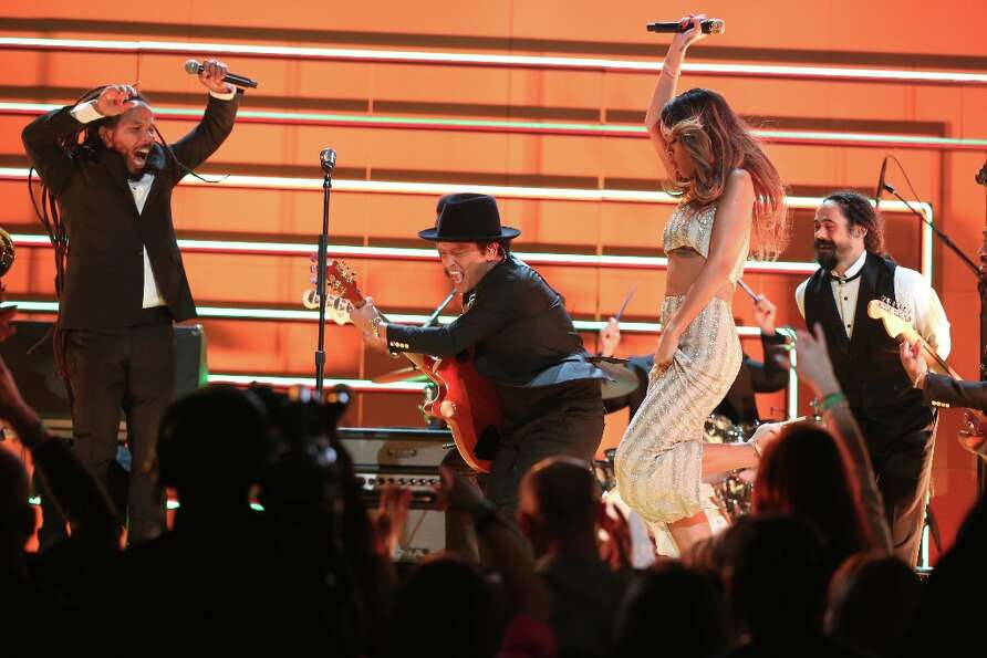LOS ANGELES, CA - FEBRUARY 10:  (L-R) Singers Ziggy Marley, Bruno Mars, Rihanna and Damian Marley pe