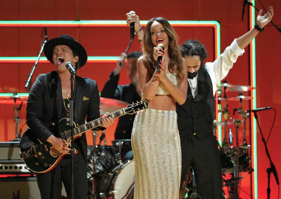Recording artists Bruno Mars, left, and Rihanna perform a tribute to Bob Marley at the 55th annual Grammy Awards on Sunday, Feb. 10, 2013, in Los Angeles. (Photo by John Shearer/Invision/AP) Photo: John Shearer, Associated Press / Invision