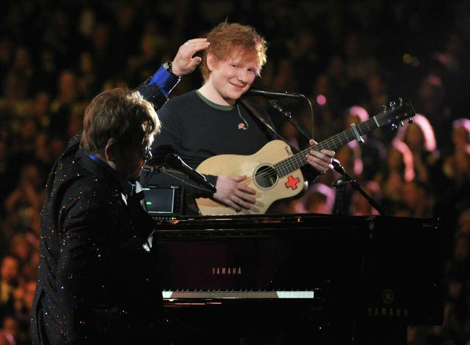 Sir Elton John, left, and Ed Sheeran perform on stage at the 55th annual Grammy Awards on Sunday, Feb. 10, 2013, in Los Angeles. (Photo by John Shearer/Invision/AP) Photo: John Shearer, Associated Press / Invision